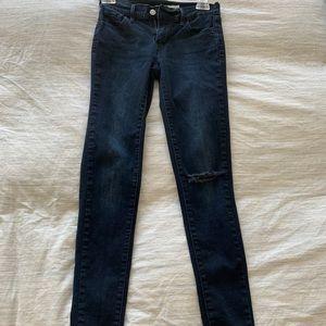 Levi's 710 dark wash knee rip jeans